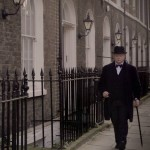 Churchill walking down the street during the war